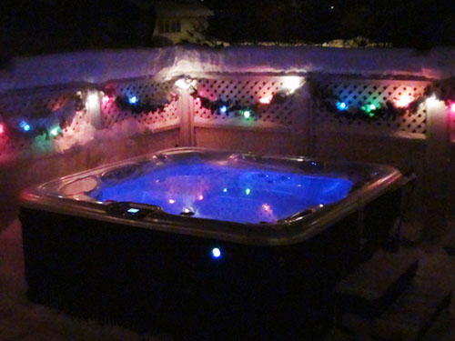 A late-night atmosphericly-lit hot tub